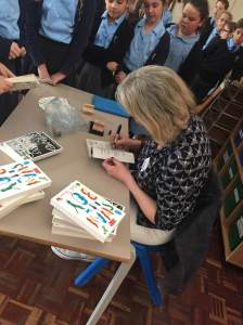 Busily signing books